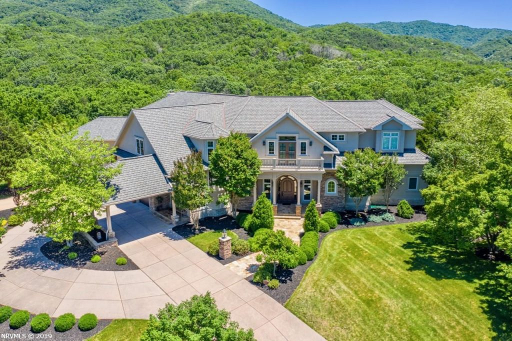 This nearly 9,000 square foot home has four fireplaces, a golf simulator, exercise room, hot tub, treadmill hot tub, game room and spacious covered open patio with fire pit, koi pond and beautiful mountain views, as well as a famous owner.