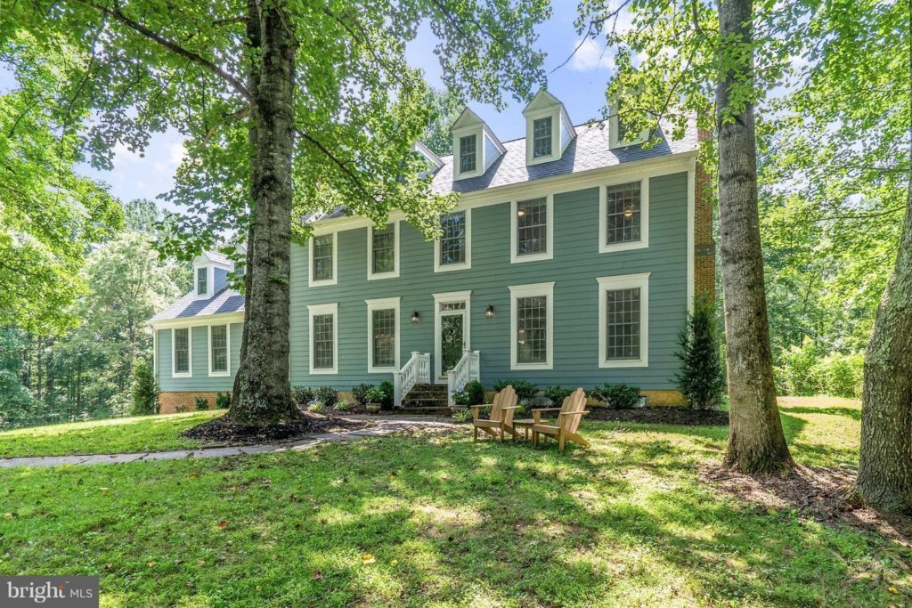 This Colonial Williamsburg-style home is situated on six wooded acres with views of the Blue Ridge Mountains. Its hardwood floors on the main level, recently updated kitchen, overlooking a park-like back yard, and huge back deck make it perfect for summer entertaining or year-round living.